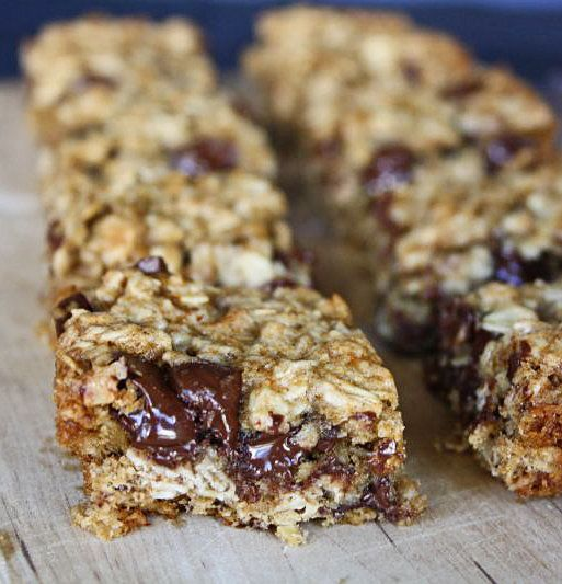 Recipe for Banana Oatmeal Breakfast Bars - Soft and chewy oatmeal bars with a great hit of banana flavor, speckled with chocolate chips, baked and served warm. Don't let the oatmeal fool you, these are breakfast, lunch, dinner and dessert, if you ask me!