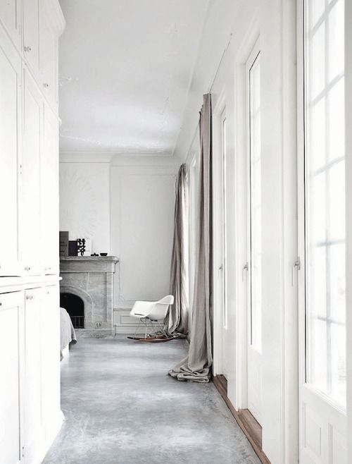 grey flooring white walls long curtains fireplace romantic bedroom white wardrobes