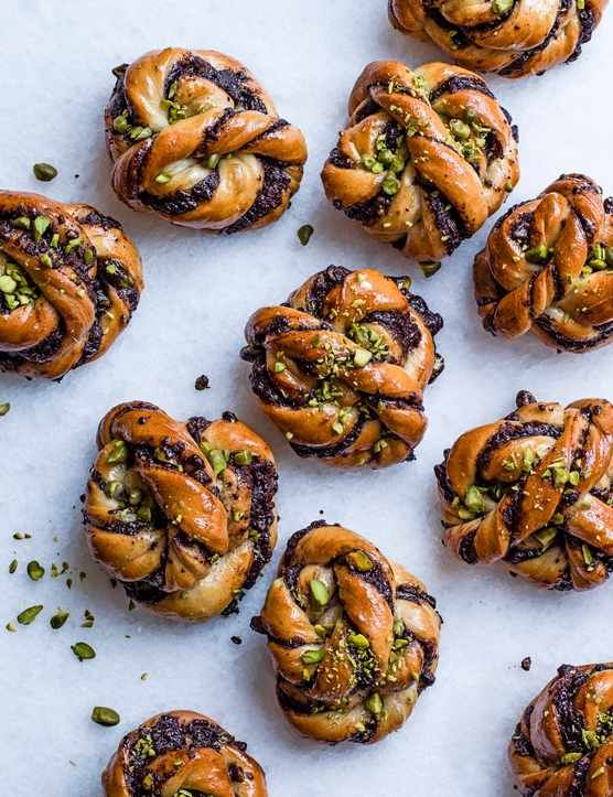 Chocolate and salted pistachio babka buns  Edd Kimber has crossed the flavours of a babka with the look of Swedish cinnamon buns to create these chocolate and salted pistachio babka buns. You can make these with regular pistachios, but if you want to push them a little further it's worth tracking down vibrant green blanched slivered pistachios from Middle-Eastern grocers.