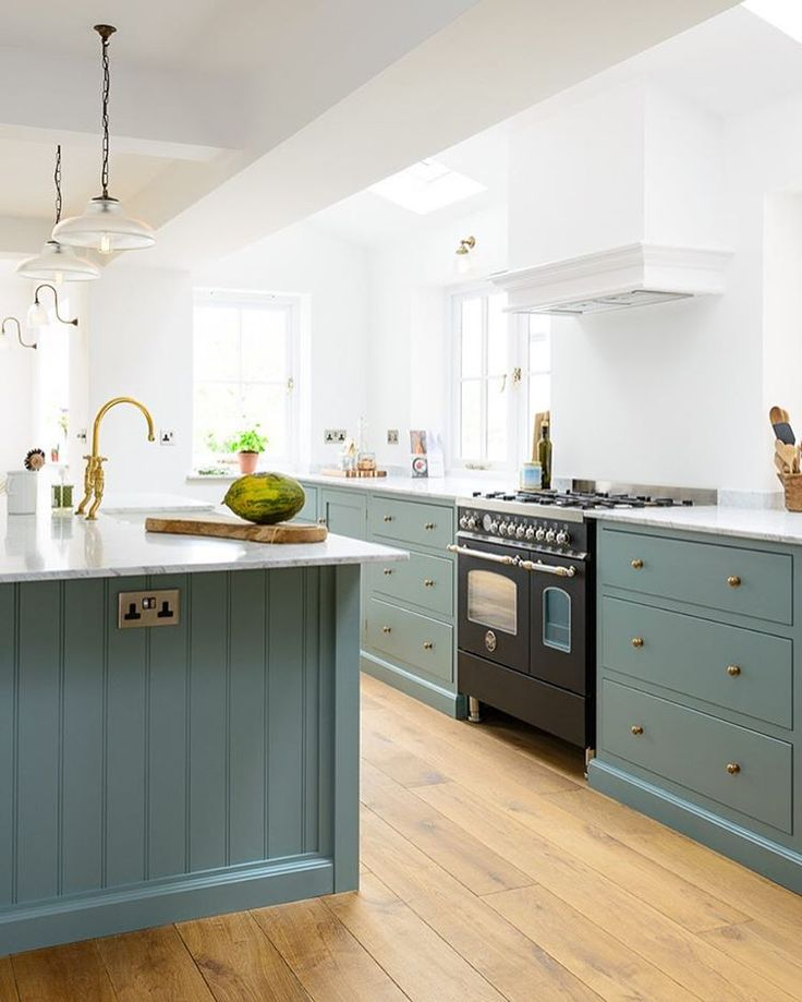 The beautiful new Trinity Blue Kitchen featuring an amazing black @bertazzoniitalia range cooker   deVOL Kitchens