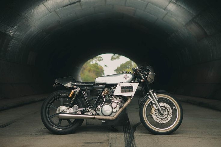 Arden's Yamaha SR400 custom. This shot was taken in the tunnel of NSW's Old Pacific Highway.  The bike was placed in the sunlight in front of the tunnel and a small flash gun placed halfway down the tunnel on a trigger. We think it really shows off the size of the tunnel as an unlit version makes the tunnel look like a dense black object. #ninetynineco #motorcycle #custommotorcycle