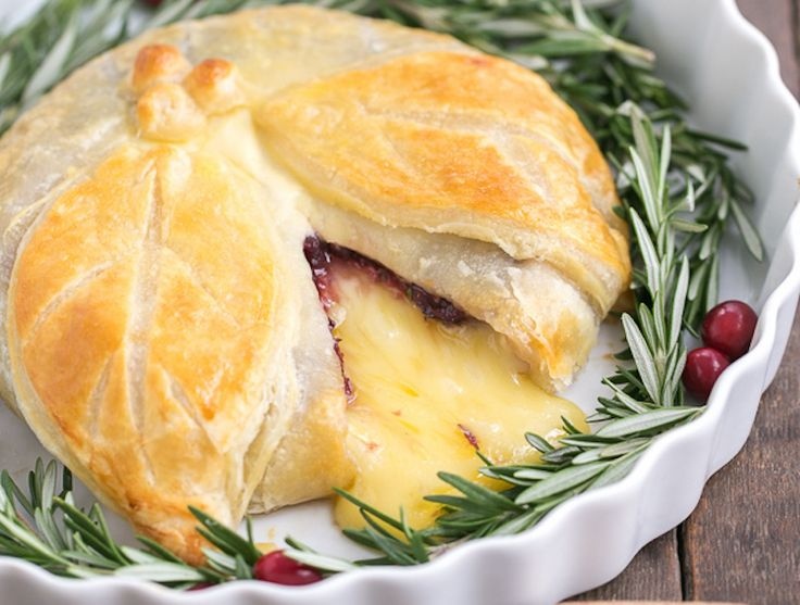 Cranberry Brie en Croute is topped with herbed cranberry sauce and wrapped in flaky puffed pastry. The perfect, warm appetizer for a cold winter day.
