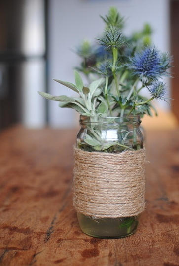 VASE Wrap twine around an old spaghetti sauce bottle to add some country charm.