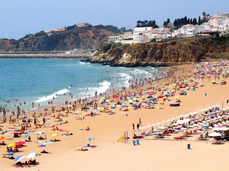 Fishermans beach in Albufeira is supervised and has a  gorgeous sandy beach.  If you feeling adventurous you can book para sailing from this beach.   http://www.greatholidaylocations.com/things-to-do/algarve-beach/