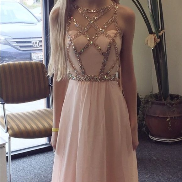 "Beautiful Faviana prom dress style 7759 in soft peach. Worn once and altered as shown to fit a true 00. 23"" waist. Length fits about 5'5"" (I am about 5'1"" and wore heels). Rose gold crystal detailing. Additional photos can be provided upon request. Bought for $440! Seeing if anyone is interested"