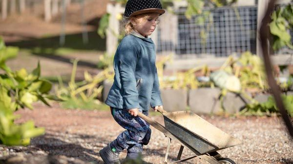 Surf Check Pullover and Dig Deeper Harem Pant doing yard work with his wheelbarrow.