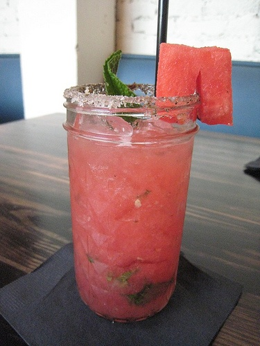 Daytripper: fresh watermelon juice, St. Germain, Tito's vodka, and mint, garnished with a big chunk of watermelon. Soooo refreshing.