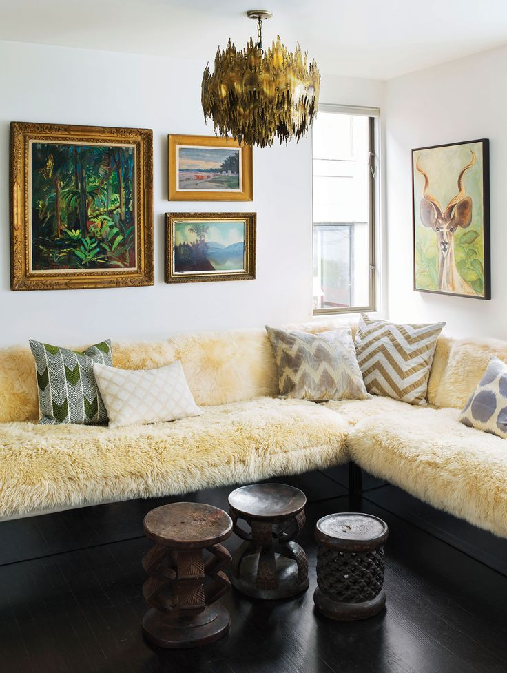 The family room's Milo Baughman sofa, covered in long-haired sheepskin.