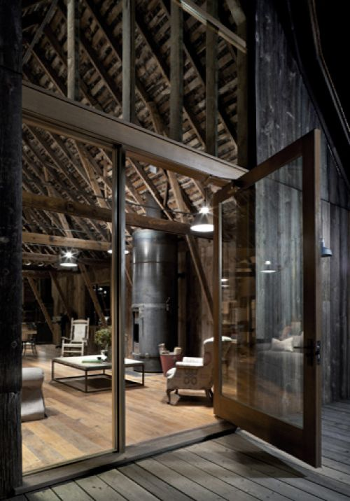 This barn has been converted with the dark wooden roof in mind and these glass partitions allow light to travel through and brighten up the interior perfectly, without spoiling the impact of the ceiling beams