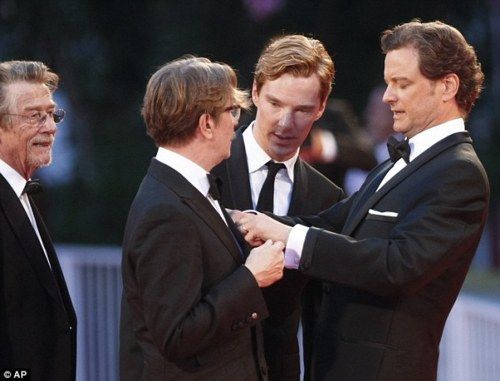 Mr. Darcy fixes Sirius Black's tie while Sherlock Holmes consults and the Doctor watches.