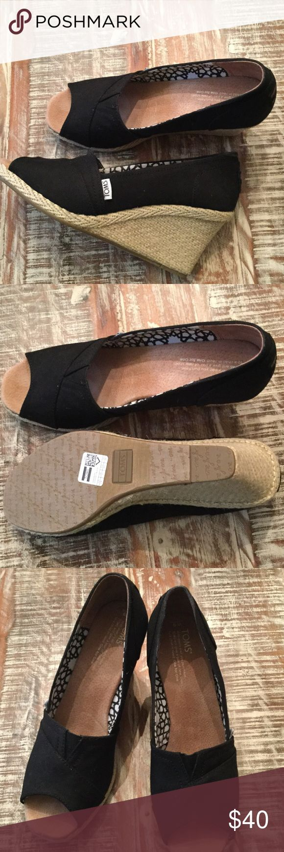 Practically NEW Toms espadrilles Like new condition, black canvas Toms with jute wrapped heel. Only worn briefly in my home to try. TOMS Shoes Espadrilles