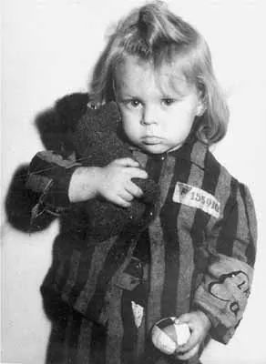 Child Survivor This little girl, who was photographed in Prague, Czechoslovakia, still wears her camp uniform while holding a stuffed animal and a ball, toys she undoubtedly held dear. Photo: Lydia Chagoll/United States Holocaust Memorial Museum Holocaust Social Archive