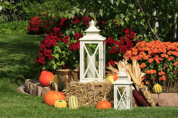 With hay bales, mums, and pumpkins, it must be Fall!  Add a few Moonrays lanterns and candles, and you'll have an attractive Fall display.
