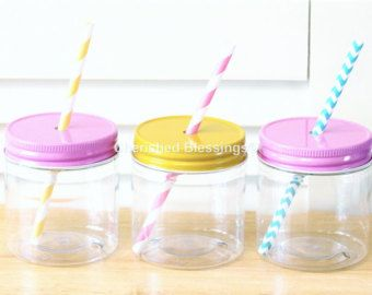 PLASTIC MASON JARS, PLASTIC MASON JAR CUPS WITH STRAW LID, SOLID LIDS, OR DAISY LIDS,17oz or 8oz MADE IN THE USA.  Plastic mason jars are sold in quantity of 10. These plastic jars are 17 oz or 8oz. 17oz cups are approximately 5 inches high and a diameter of 2.75 inches. The 8oz cups are roughly 3 inches high and a diameter of roughly 2.75 inches. Your choice of solid lids without holes, daisy lids with flower cutout design, or straw lids with a single hole. The straw lids have a hole that…