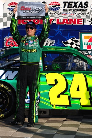 Jeff Gordon celebrates after qualifying first for the NASCAR Sprint Cup Series Dickies 500 at Texas Motor Speedway on Friday in Fort Worth.