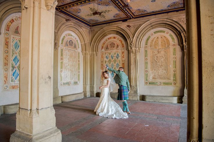 bride and groom, dancing under Bethesda Terrace in Central Park, following their wedding