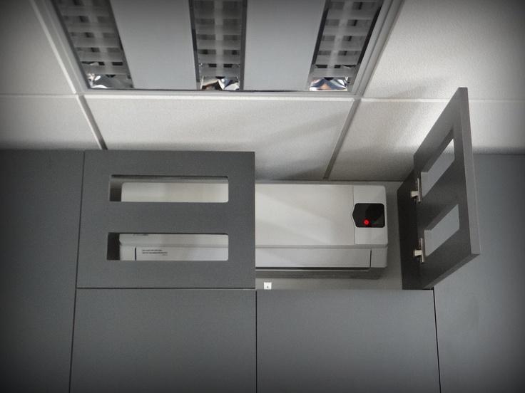 Parte superior de mueble que incorpora aire acondicionado dentro del diseño.
