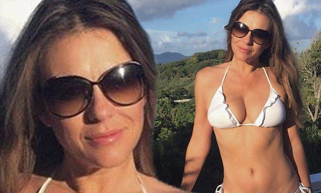 Elizabeth Hurley, 50, shows off her womanly figure in white bikini