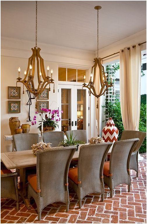 Wooden Chandeliers by Currey & Co. hanging in covered patio