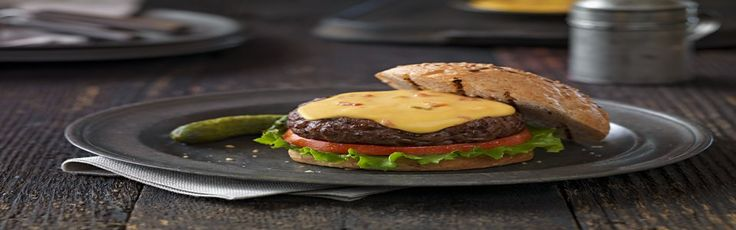 How do cheeseburgers technically become Queso Burgers? By being topped with a melty mixture of VELVEETA and RO*TEL Diced Tomatoes & Green Chilies.