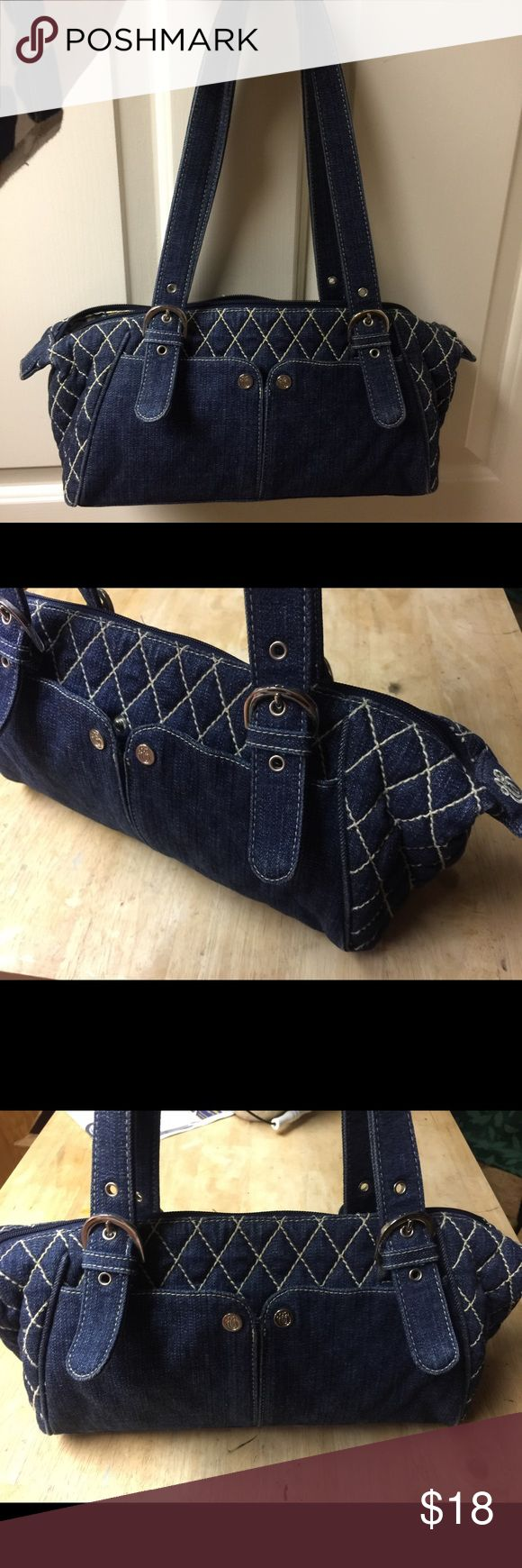 """Vera Bradley Shoulder Bag Denim quilted with blue and white paisley lining.  Length of purse is 10"""" and depth is 7"""".  There are 2 pockets on the outside and a large zippered pocket on the inside.  Gently used condition Vera Bradley Bags Shoulder Bags"""