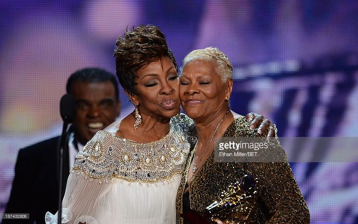 Singer Dionne Warwick accepts the Legend Award from singer Gladys Knight onstage at the Soul Train Awards 2013 at the Orleans Arena on November 8, 2013 in Las Vegas, Nevada.