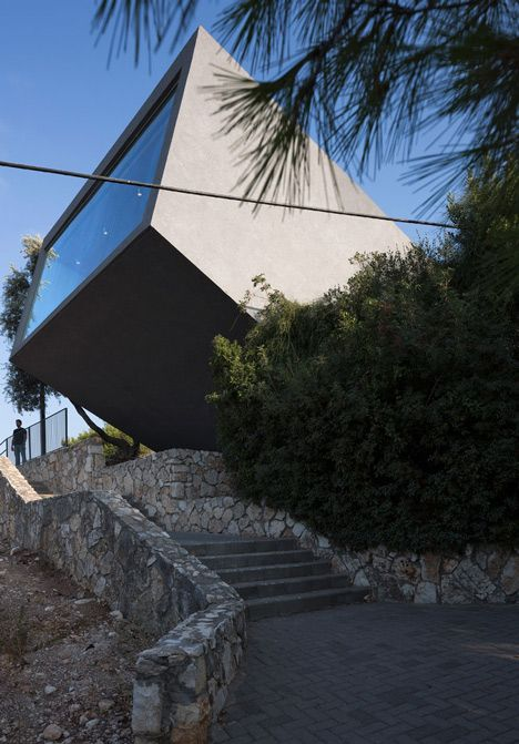 This concrete extension added to a war memorial in Israel tilts up towards the sky