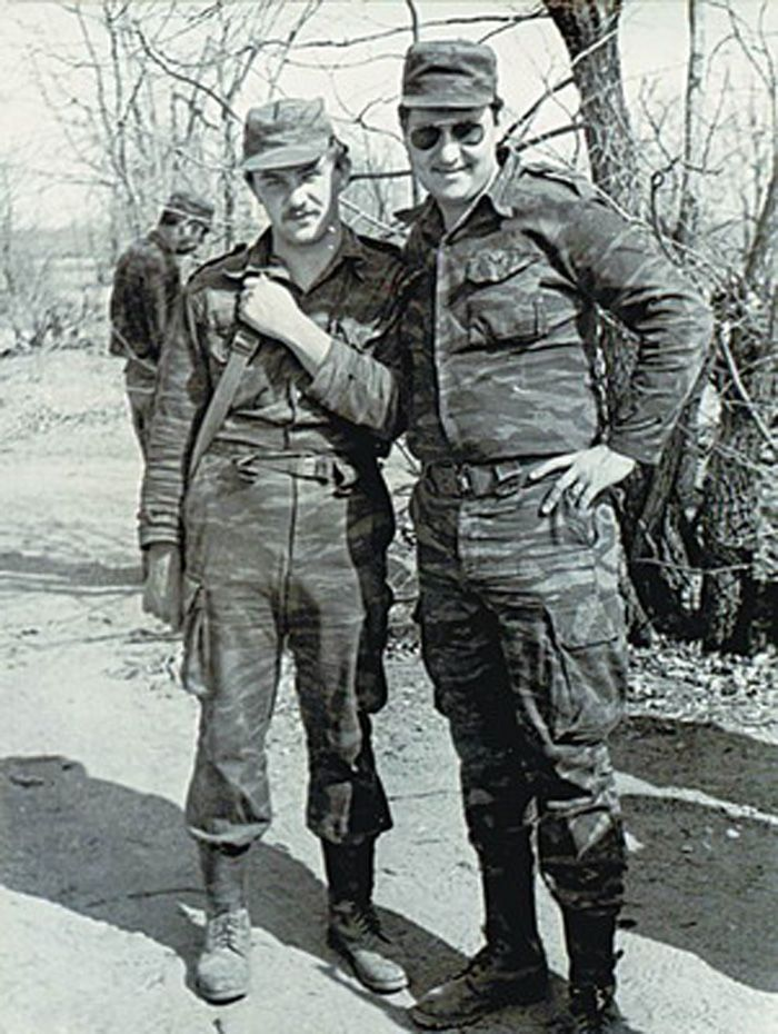 Soviet officers pose during a battle in Angola sometime in the early 1980s.