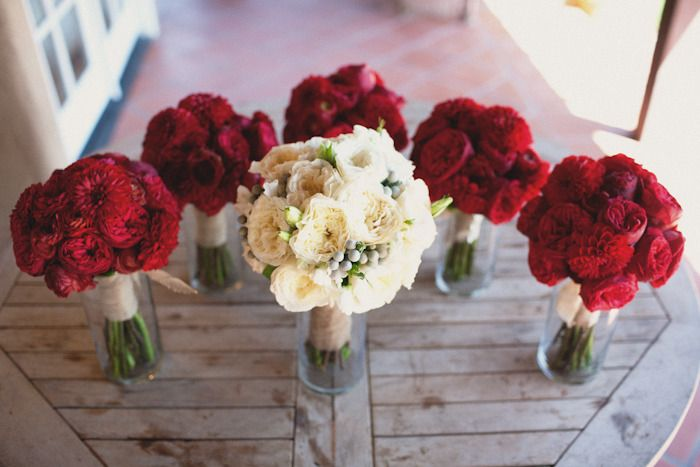 LOVE these red flowers! red bouquets include garden roses, dahlias, and a few ranunculus.