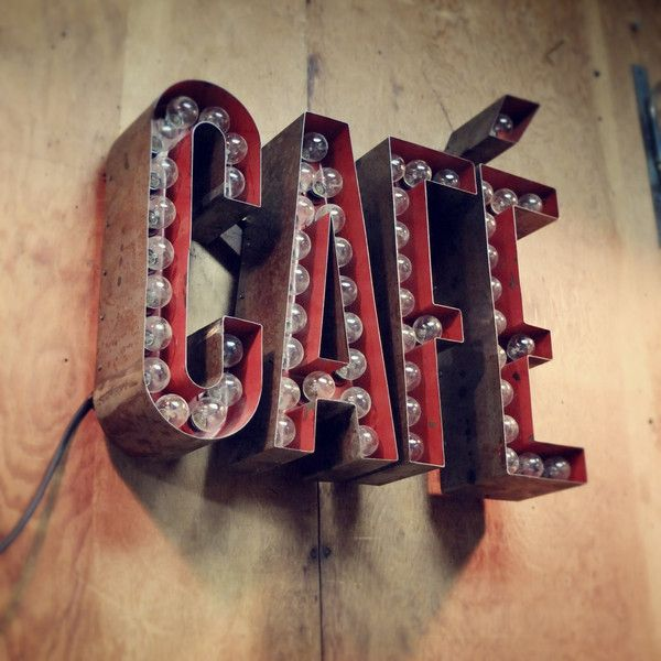 sideshow cafe sign