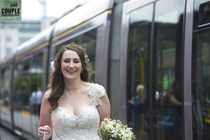 The bride & the Luas on Harcourt Street. Wedding in The Abbey Tavern, Howth. Photographed by Couple Photography.