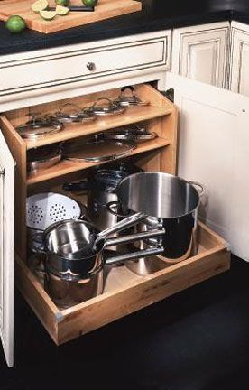 Did you know our Kitchen Specialists love roll out shelving? Of course you did but here's one more option, a pots and pans pullout! Cabinet Options | Custom Kitchen & Bath Cabinets | Kemper | 41 Lumber