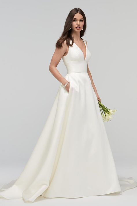 This sleek WTOO 19200 Andrina sleeveless Mikado bridal dress showcases a V-neckline, a wide empire waistband and a V-back accented with covered buttons. The luxuriant A-line skirt features concealed side seam pockets and cascades into a cathedral train. #Dress #weddingdress