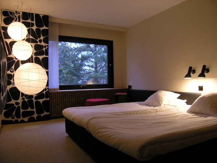 Oblique wall light at the Yasuragi wellness hotel in Sweden. From Cph Lighting dk