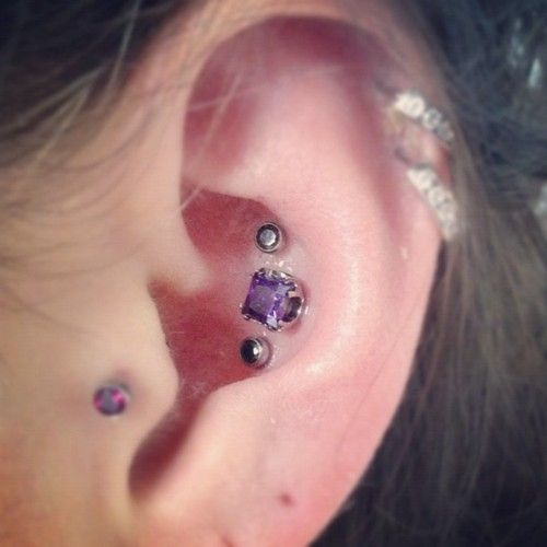 triple conch piercings with anatometal jewelry #piercing #anatometal