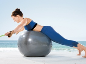 Arm Sweep A Anchor the center of a resistance tube at knee height in front of a stability ball. Lie facedown with belly centered on ball and grasp a handle between thumb and palm of each hand. Raise arms in a V position out to sides, palms facing out.  B Slowly sweep arms to your sides as you raise chest off ball. Return to starting position and repeat.Moving, Fit Ball, Diet, Ball Exercise, Inner Thigh, Start Positive, Health, Fitball, Workout