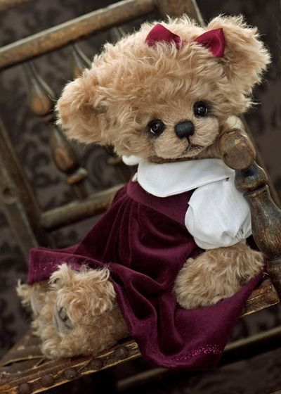 ♥ Imogen who is a sweet 15 inch girl in a plum velvet dress with white cotton sleeves and collar. She has wired arms and has the sweetest expression.