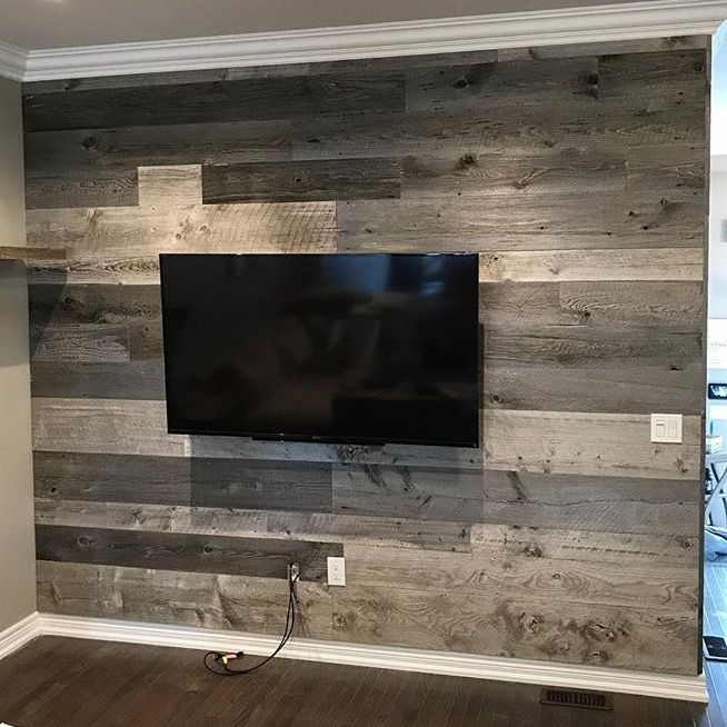 Check out this awesome grey barn board feature wall for this family room. A perfect way to make your space cozy for the whole family to enjoy!