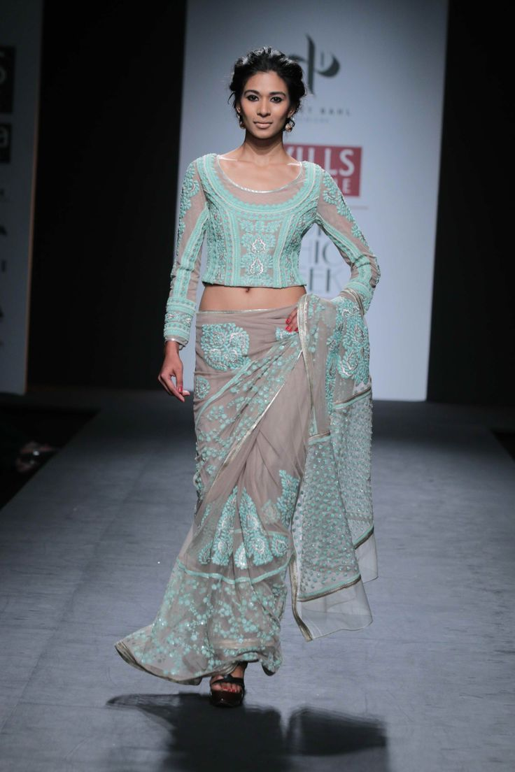 Bright sea-green shades dazzled the ramp.