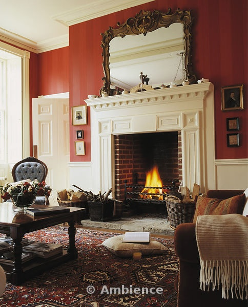 ambience images ornate mirror above fireplace in traditional red living room - Fireplace Rugs