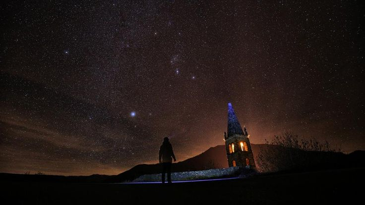 A photographer prepares to take pictures of the annual Geminid meteor shower on the Elva Hill, in Maira Valley, near Cuneo, northern Italy on Dec. 12, 2015