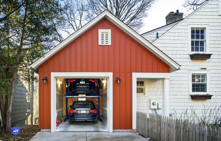 The city lot wasn't large enough for a two-car garage, so architect Todd Hansen designed an attached garage that holds two cars stacked on top of each other.