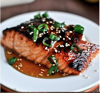 4 pieces Salmon, rinsed and patted dry 1/4 C olive oil 2 T Sesame Oil 2 T Soy Sauce 2 T Brown Sugar 2 T Rice Wine Vinegar 2 T dijon mustard 2 Garlic cloves, mined 1 T minced ginger or 2 t ground ginger 4 green onions, washed and diced thinly Glaze 1/4 C Honey 1/2 t ground ginger 1 t Soy Sauce 1 t Sesame Oil 2 T Toasted Sesame Seeds