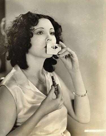 1920s silent film actress Raquel Torres using a lip stencil: