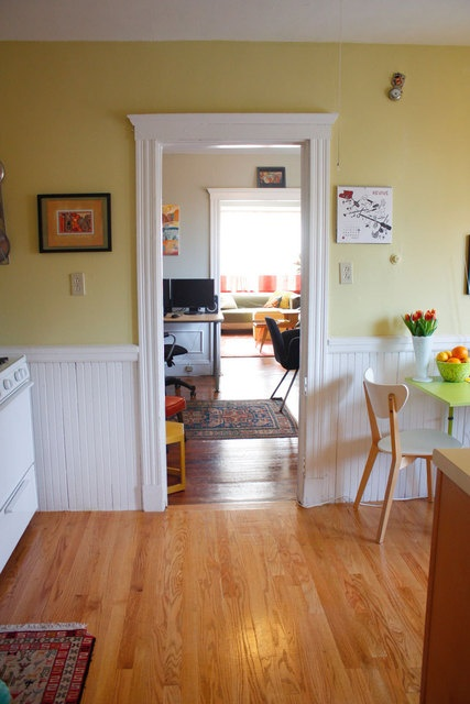 The more i see yellow with a white chair rail and What color cabinets go with yellow walls