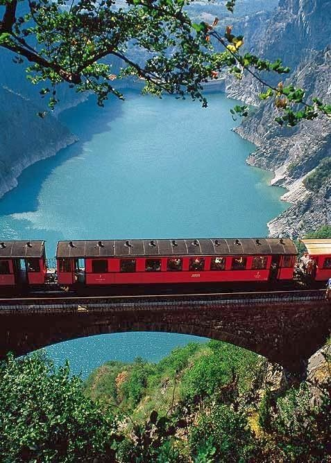 This is a picture of a train on a Mountain Railway in Grenoble, France. The scenery is beautiful.