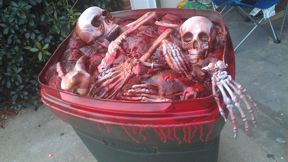 New barrel topper1 - Old unused Rubbernaid trash can1 - Bag-O-Bones1 - Left over skeleton parts from Walgreens Skelly (after cutting neck down for use on butcher table)3 - Cans of Great Foam1 - Can of red spray paint1 - Can of red mahogany laquer spray paintResult