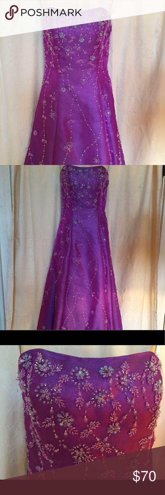 """Alfred Angelo Gorgeous Strapless Gown Sz 0 NWOT Beautiful Alfred Angelo Full Length Gown in """"Grape Jam""""  This Strapless Dress is gorgeous with an iridescent purple sheen that just shimmers. Detailed beading and sequins are also iridescent which sparkles.  I purchased this gown for my daughter's formal, but she never wore it. It is from designer Alfred Angelo and is Size 0.  There are a few loose strings on back of Gown - see photo - but all beading is in tact. Excellent condition, full slip…"""