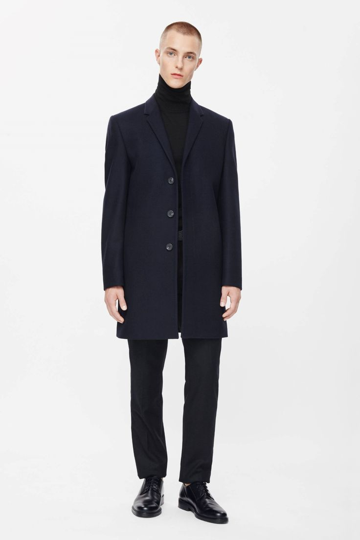 Made from a blend of wool and cashmere with a soft felted texture, this classic coat is a tailored straight shape. Fully lined, it has narrow notched lapels, inside and outside pockets and hidden front buttons for a neat finish.