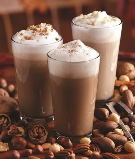 Torani Hazelnut Latte // INGREDIENTS: 1oz. Torani Hazelnut Syrup, 8oz Milk, 2 shots Espresso* // INSTRUCTIONS: Steam milk and Torani Syrup together. Pour heated, flavored milk into a tall glass and add brewed espresso*. Spoon a thin layer of foamed milk over beverage. // *If needed, 1/2 cup strong brewed coffee can be substituted for 2 shots espresso.
